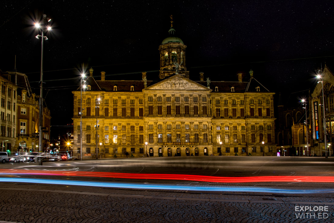 Former Royal Palace in Amsterdam taking at night with passing traffic captured by long exposure