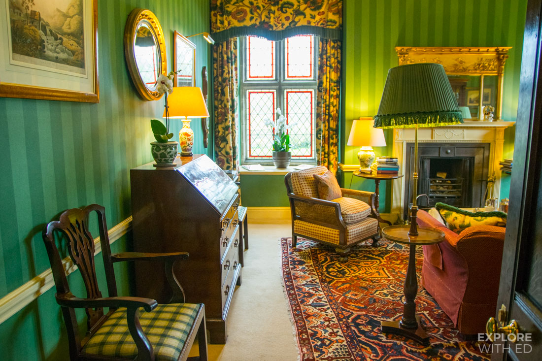Tastefully decorated Georgian House with Green Striped Wallpaper and Antique Furniture