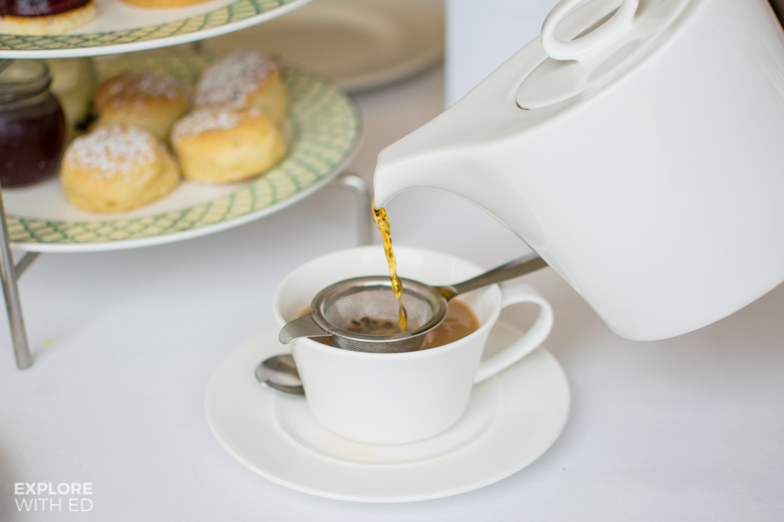 Pouring a Assam Breakfast Tea with Scones at The Celtic Manor