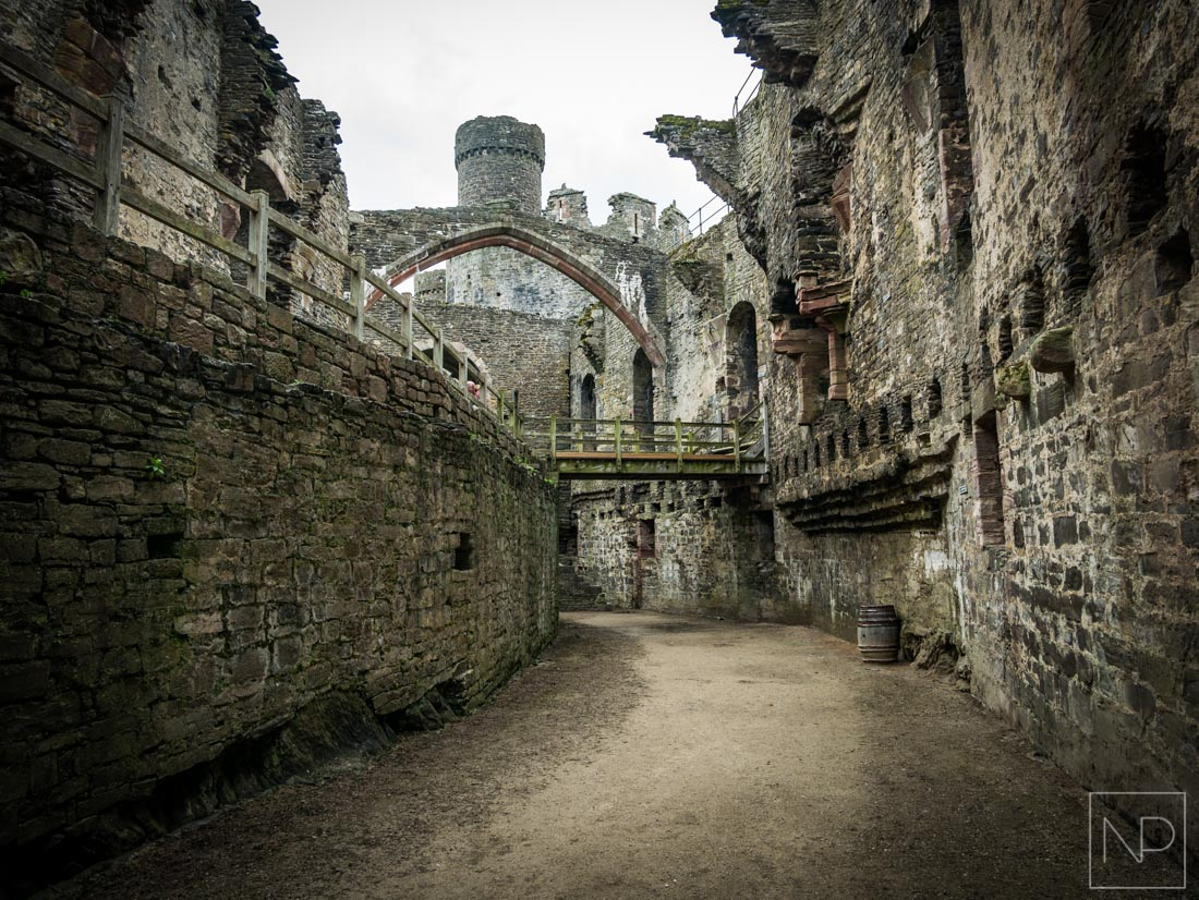 Ground level Conwy Castle with arched ceiling remains