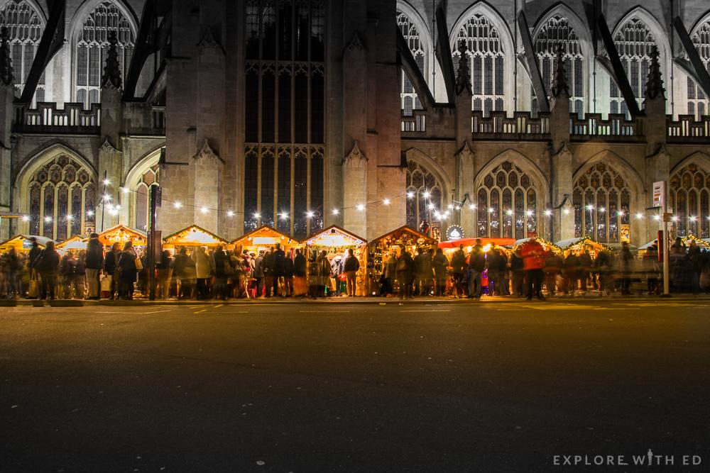 Bath Christmas Market at night besides Bath Abbey