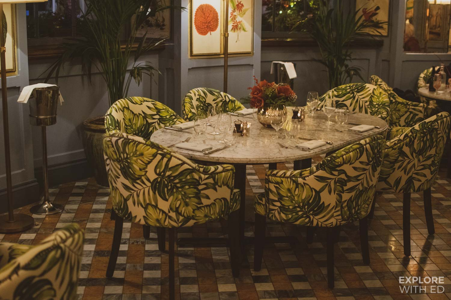 The Ivy Bath Brasserie dining area with patterned seating and marble tables
