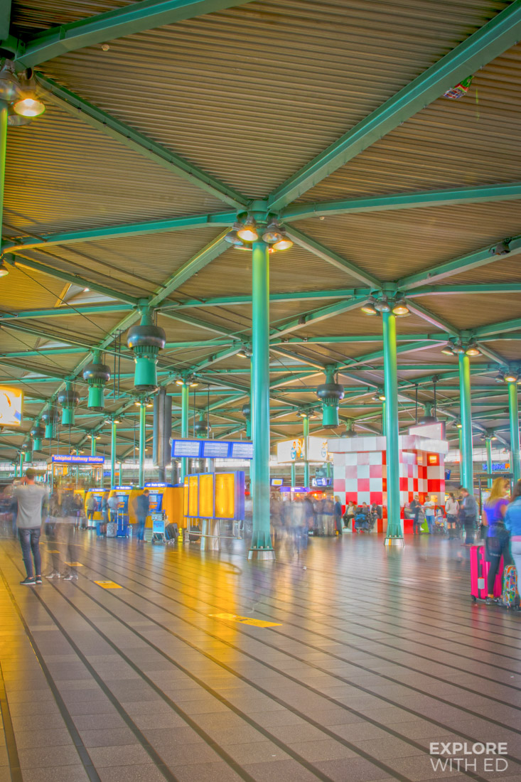 Departure Hall in Schiphol Airport with restaurants and shops