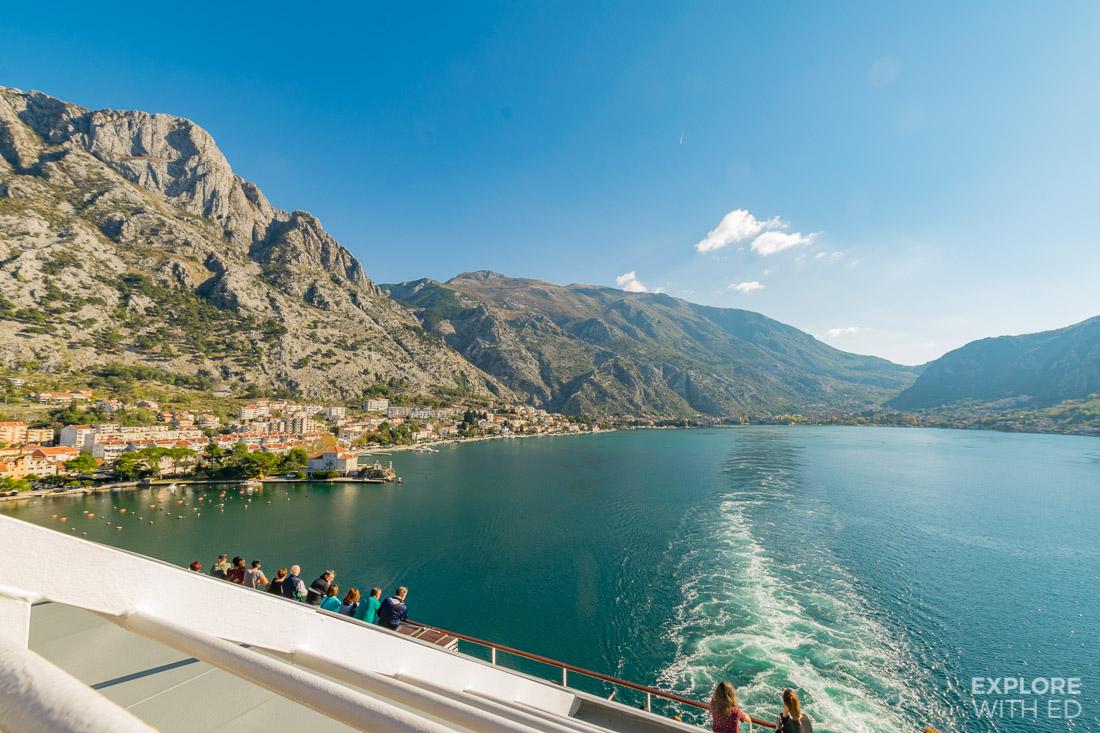 Cruise ship sail away in the Bay of Kotor