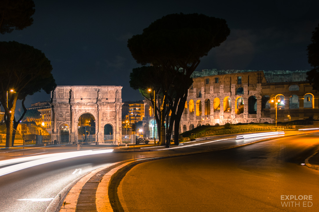 Long exposure night time photo of the Colosseum with passing traffic