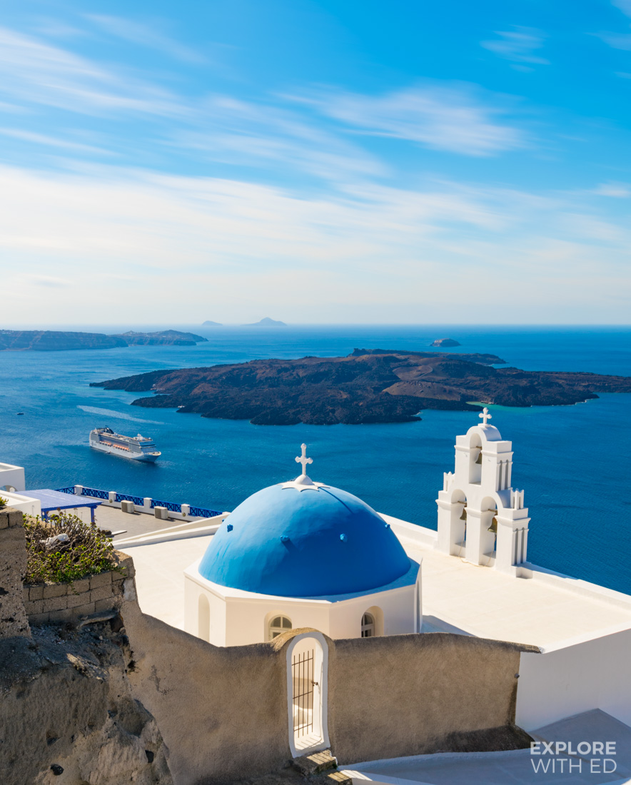 Incredible views from Fira over Santorini's iconic blue domed buildings and caldera