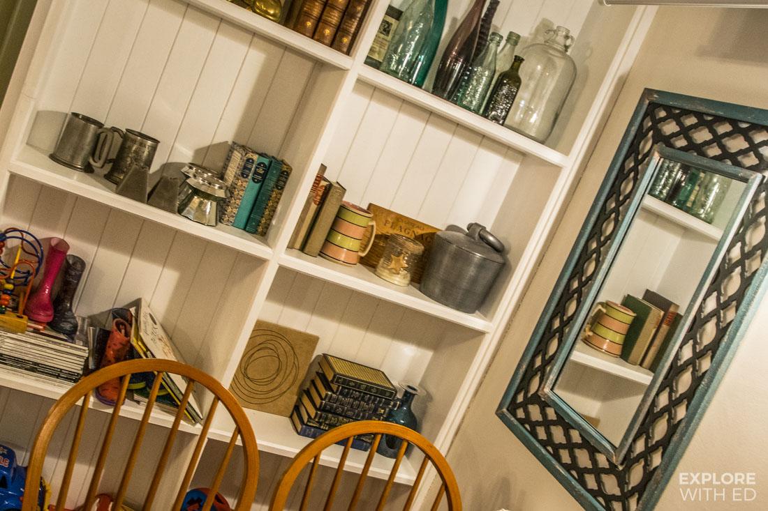 Restaurant design with stylish white panelled shelving unit