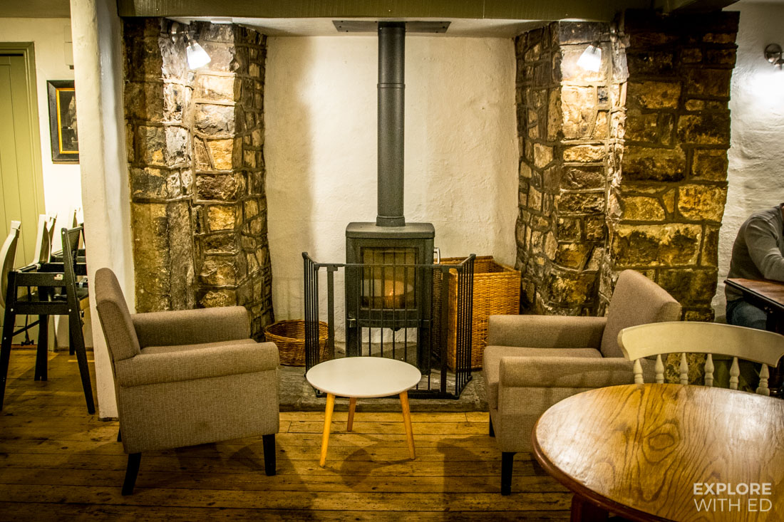Stylish restaurant interior with wood burner and comfortable lounge chairs